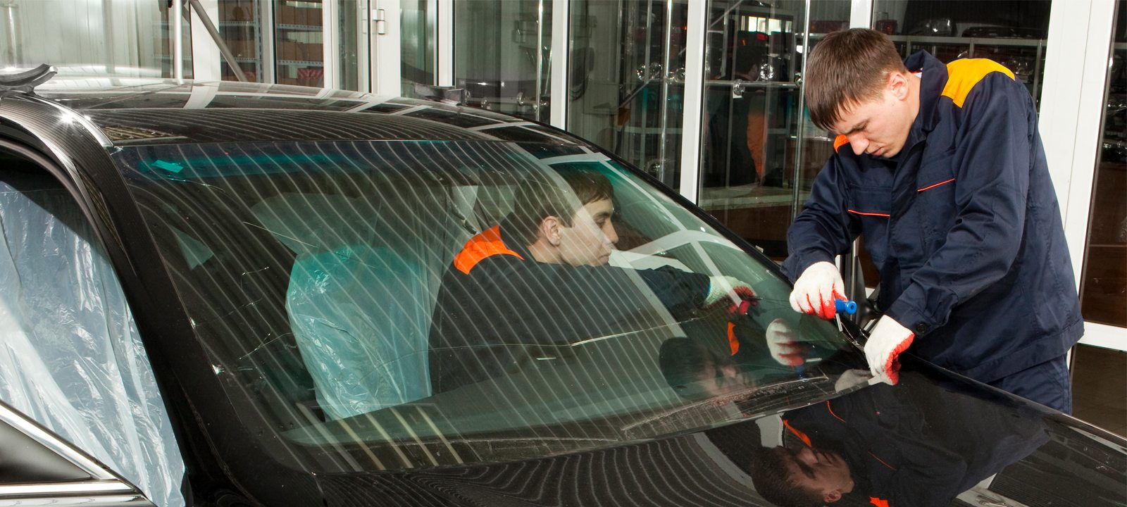 Auto Glass Technicians replacing a windshield